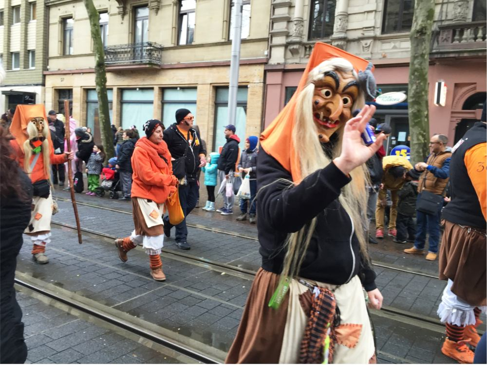 german farsching wearing masks and costumes