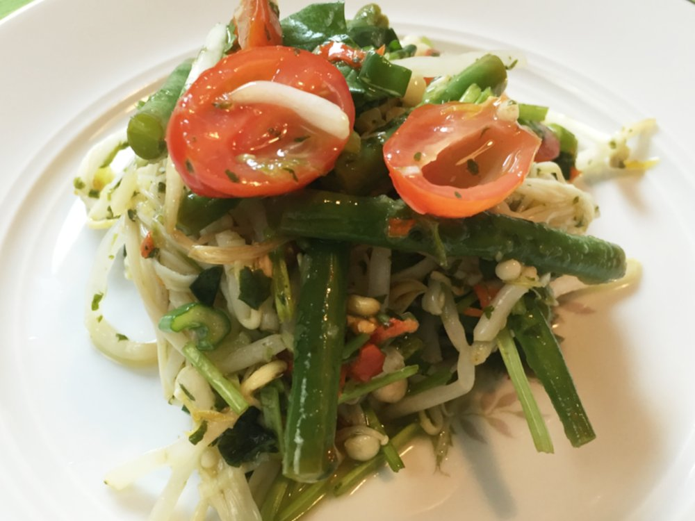 Thai mushroom salad with green beans and bean sprouts, close shot